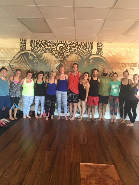 Yoga with my team this morning. My shirt is soaked with sweat!